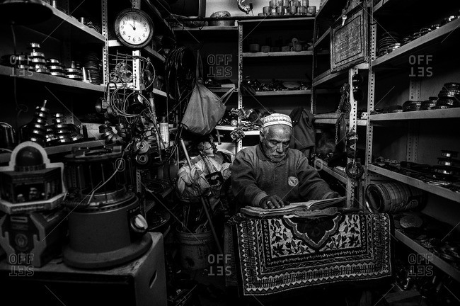 Man praying in his workshop