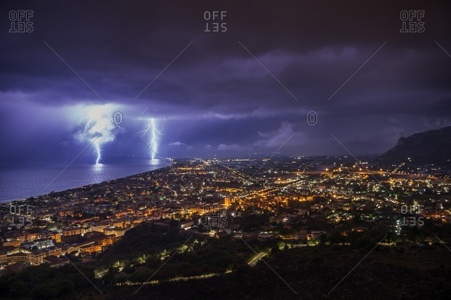 Double bolts of lighting strike the sea in Terracina, Italy