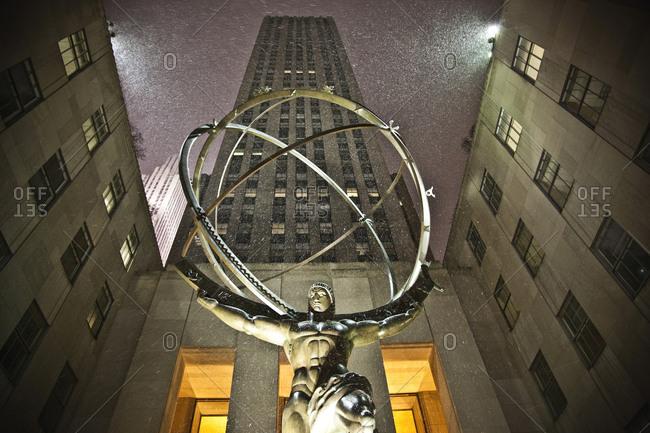 New York City, USA - December 19, 2009: Statue of Atlas during snowfall in Rockefeller Center, Manhattan