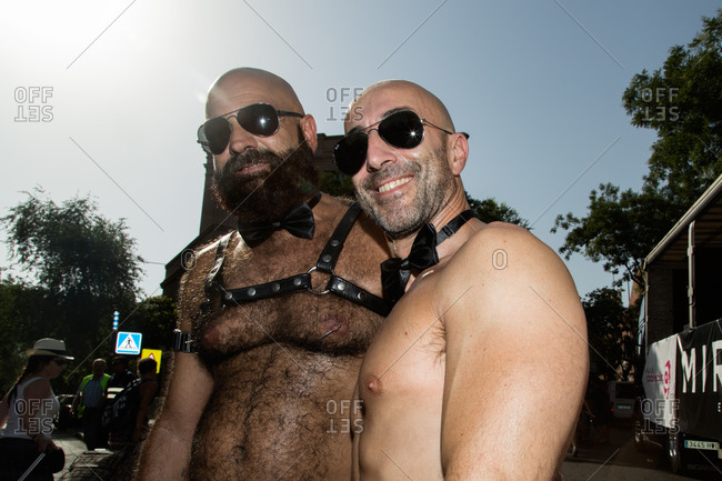 Madrid, Spain - July 4, 2015: Two shirtless men in bow ties at gay pride celebration in Madrid