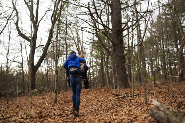 Kid getting piggyback ride in woods