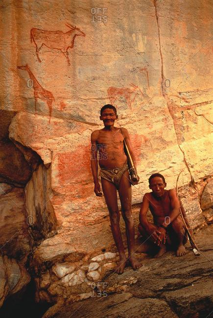 Kalahari Desert, Botswana, Africa - January 23, 2015: Bushmen in Botswana by rock drawing