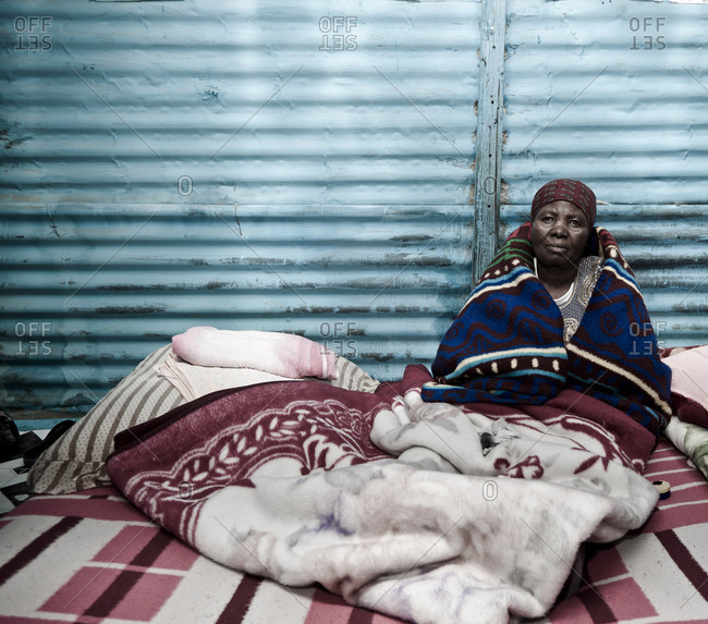 Vereeniging, Gauteng, South Africa - April 13, 2012: Woman surrounded by blankets