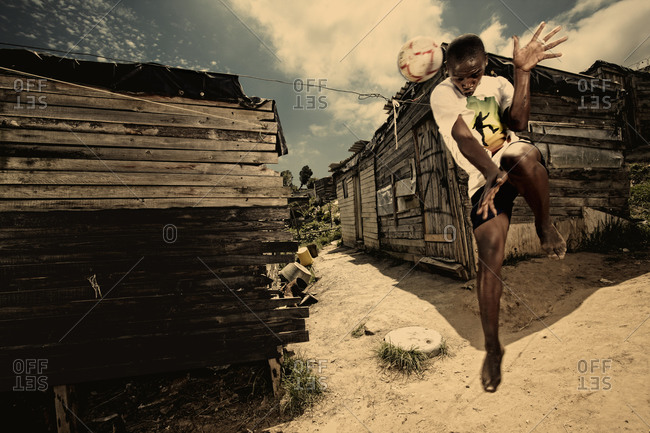 Knysna, Western Cape, South Africa - January 12, 2010: Boy hitting soccer ball with head