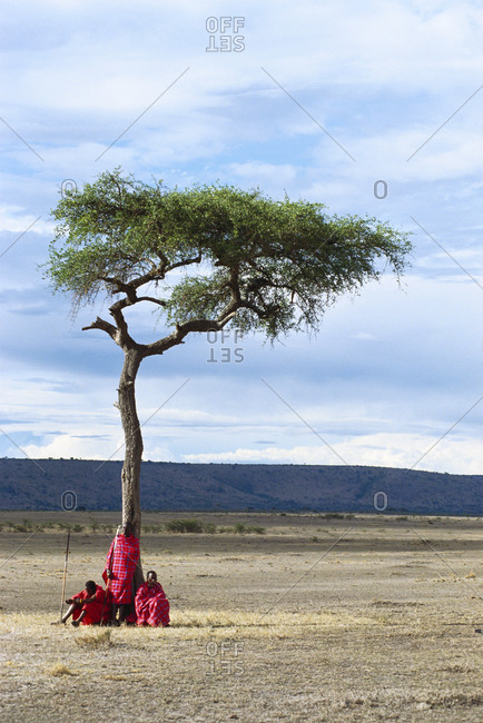 Africa - May 4, 2006: African tribesman under rural tree