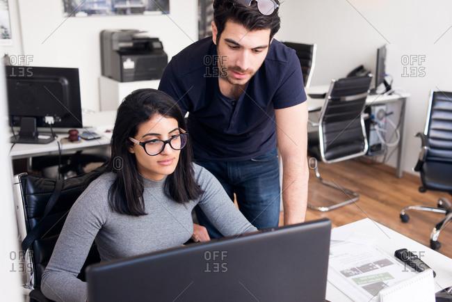 Man and woman collaborating at a real estate