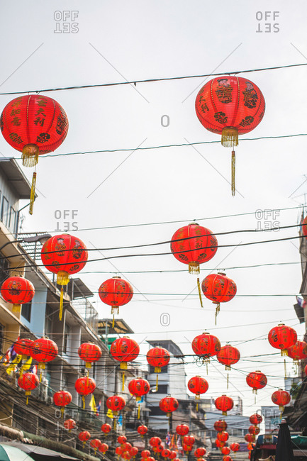 Many Chinese lanterns hung outside over a street during Chinese New Year in Bangkok, Thailand