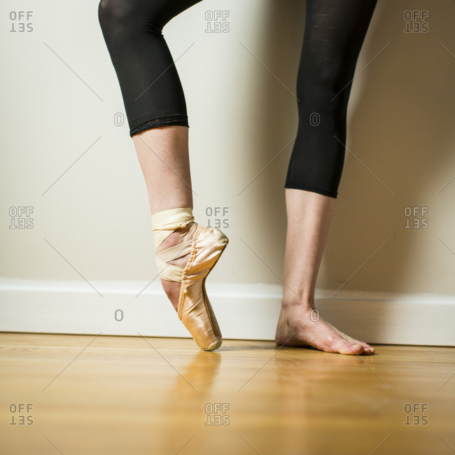 Close up of ballerina wearing one pointe shoe