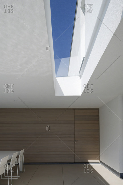 Dining room with a large skylight in a modern house