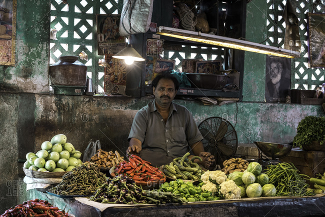 Man selling fresh vegetables at a market in Bhavnagar, Gujarat, India