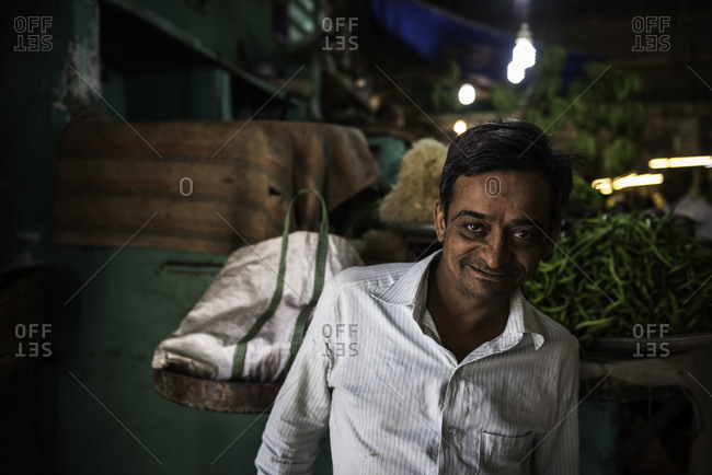 Portrait of a smiling man at a market in Bhavnagar, Gujarat, India