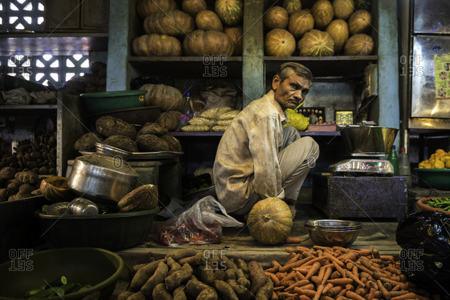 Vendor selling squash and other vegetables at a market in Bhavnagar, Gujarat, India