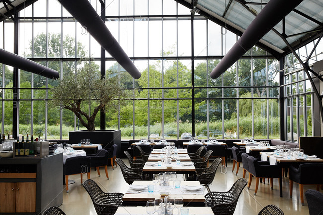 Amsterdam, Netherlands - July 4, 2015: Dining floor of a restaurant in a greenhouse