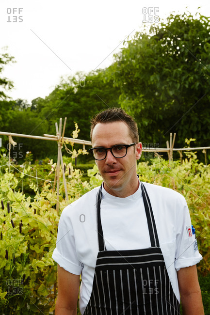 Amsterdam, Netherlands - July 4, 2015: Portrait of a chef in restaurant garden