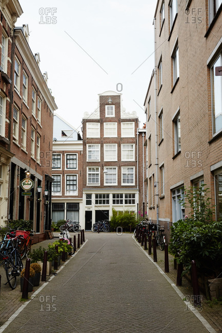 Amsterdam, Netherlands - July 5, 2015: Quaint alleyway with bicycles in Amsterdam
