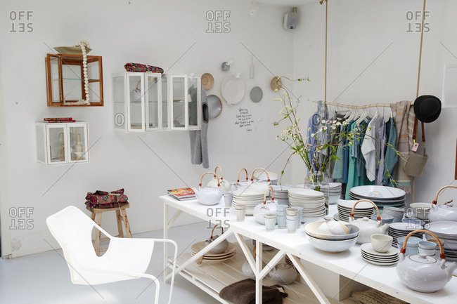 Amsterdam, Netherlands - July 5, 2015: Interior of shop selling pottery and clothing