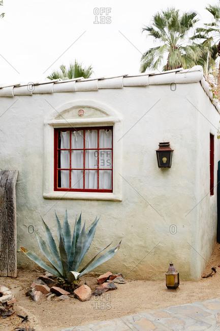 Window of a stucco home in California desert