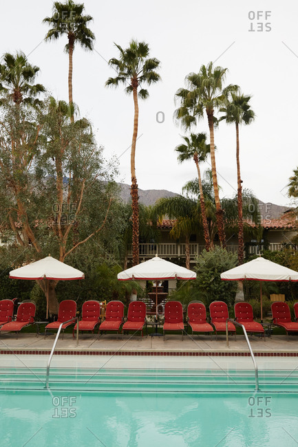 California, USA - January 26, 2015: Hotel pool with palm trees in California desert