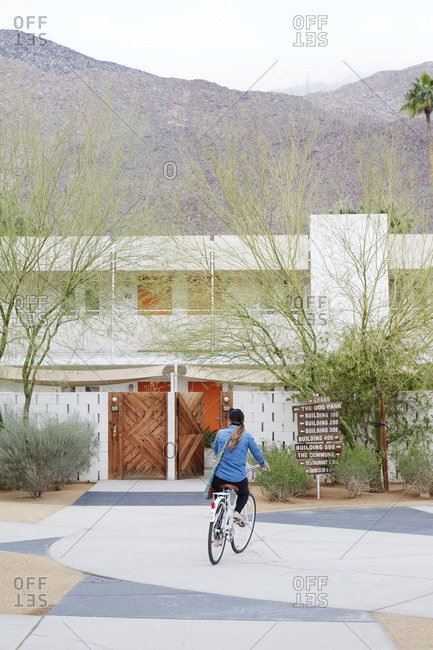 California, USA - January 26, 2015: Woman riding a bicycle at a desert resort