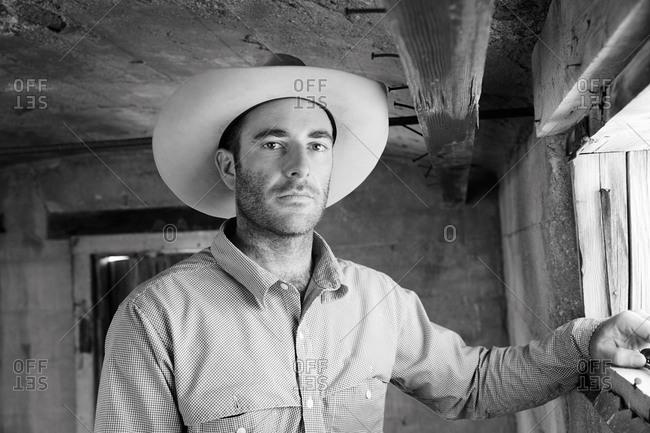 Colorado, USA - June 26, 2014: Portrait of a handsome man in cowboy hat