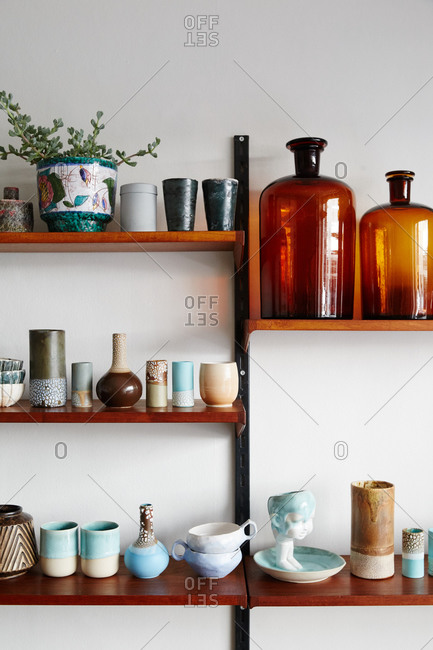 Shelf display of pottery and glass bottles