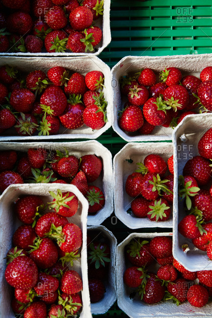 Overhead view of fresh strawberries at farmers market