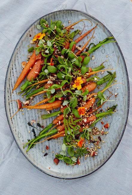 Overhead view of carrot salad on white platter