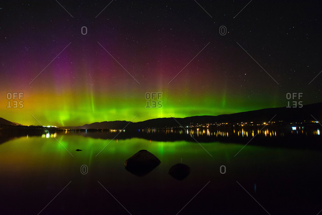 Aurora borealis over Okanagan Lake at night, Kickininee Provincial Park , British Columbia, Canada