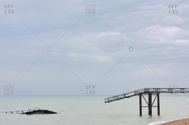Seascape with remains of old Brighton pier, Brighton, England