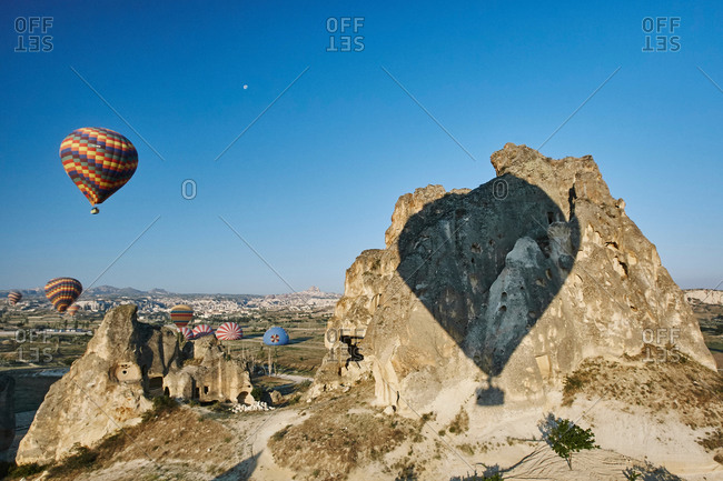 Shadow of hot air balloons on rock formation, Cappadocia, Anatolia, Turkey