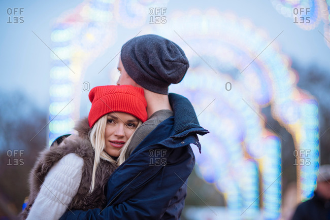 Romantic young couple at xmas festival in Hyde Park, London, UK
