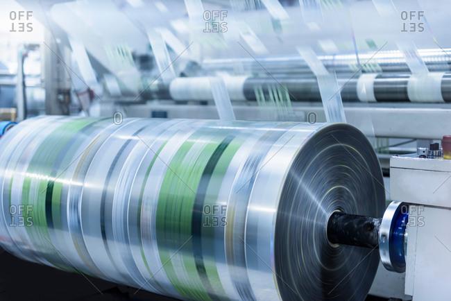 Large roll of printed plastic film in food packaging printing factory