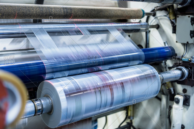Printed plastic film in roll at a food packaging printing factory