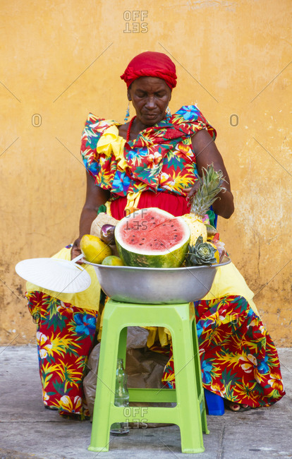 Colombian fruit seller in a bright floral dress