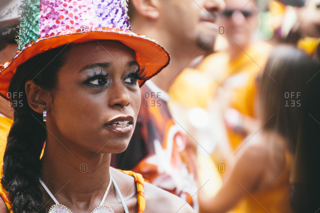 Woman with make-up and a glittery hat at Carnival