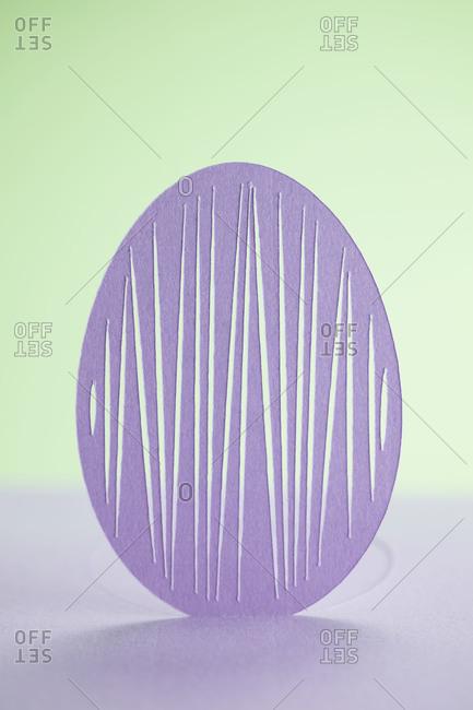 A cutout of a purple Easter egg