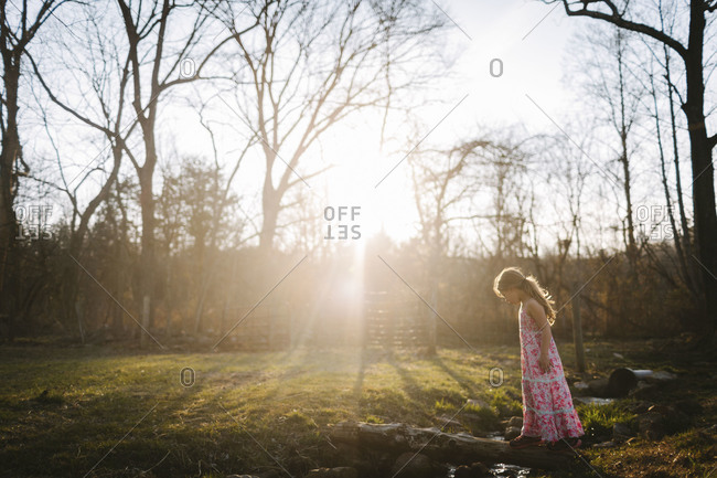 Girl by a sun dappled stream