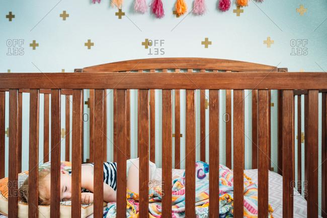 Baby sleeping in a crib