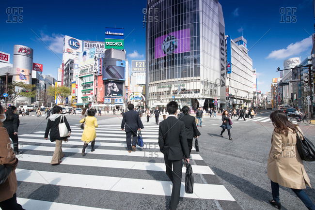 Tokyo, Japan - March 3, 2016: People walking at a city intersection