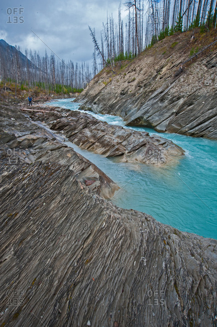 The Vermillion River flows between eroded rocks