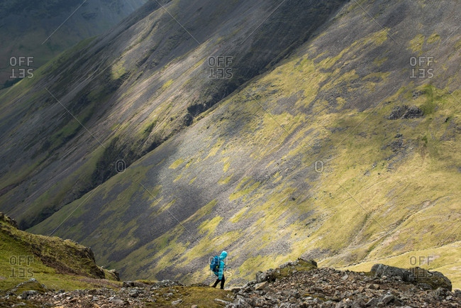 Descending on a scree slope from the top of Great Gable in English Lake District in Wast Water