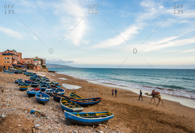 Taghazout, Morocco - April 19, 2014: Locals enjoy the sandy beaches and calm waves on a sunny day