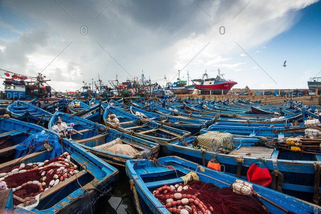 Essaouira, Morocco - April 21, 2014: Fishing boats sit quietly in a marina outside the city