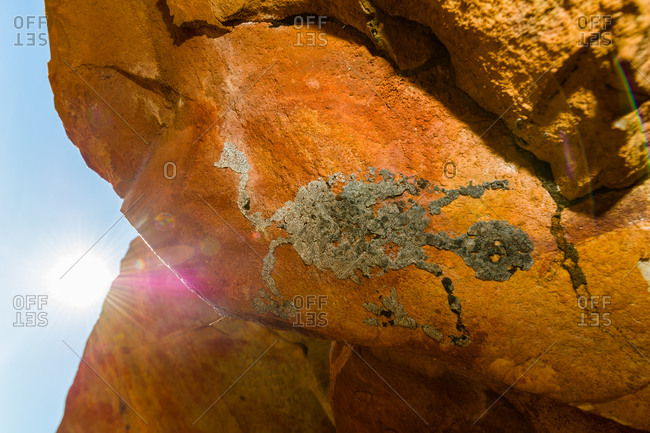 An ancient Aboriginal bees wax evil spirit on the ceiling of a sandstone cave