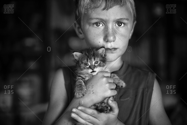 Boy holding a young cat