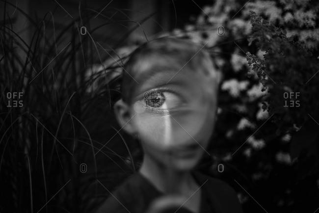 Boy's eye in magnifying glass
