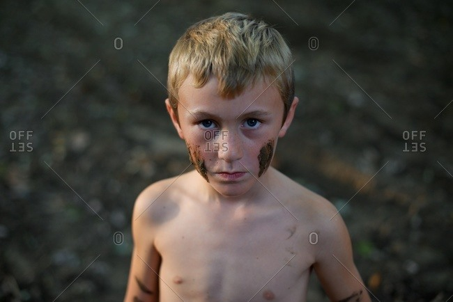 Boy with mud painted face