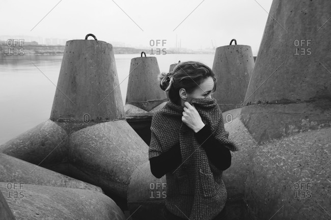 Young woman covering her nose with sweater