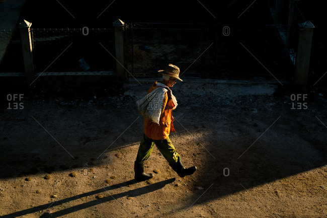 Cuba - March 7, 2016: Man walking on dirt road