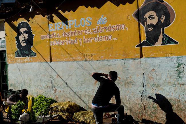 Cuba - March 7, 2016: Revolution sign above market